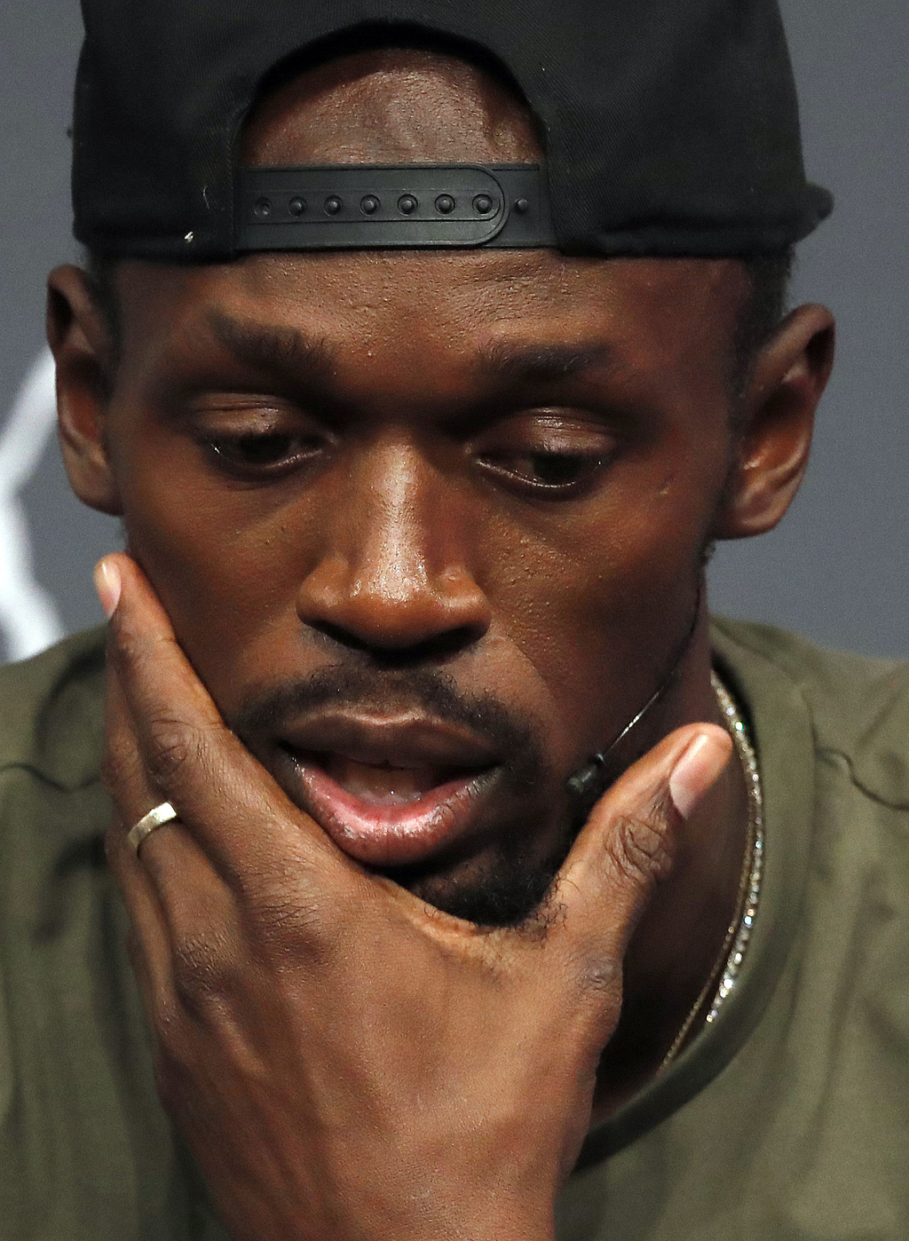 Jamaican athlete Usain Bolt pauses during a press conference ahead of the World Athletics championships in London, Tuesday, Aug. 1, 2017. Sprint legen...