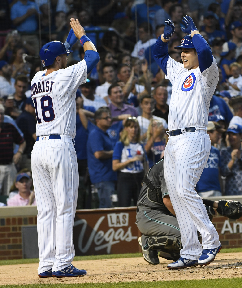 Chicago Cubs' Anthony Rizzo, right, high fives Ben Zobrist (18) after they score on his two-run home run during the second inning of a baseball game a...