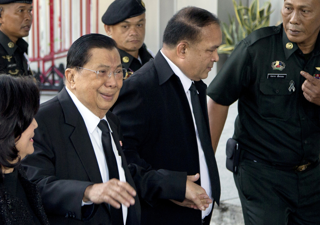 Thailand's former deputy Prime Minister Chavalit Yongchaiyudh, left, arrives at a courthouse in Bangkok, Thailand on Wednesday, Aug 2, 2017 to hear th...
