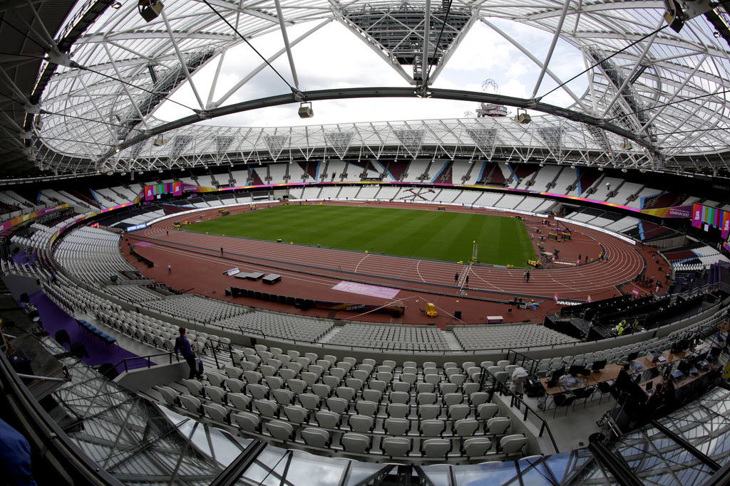 Workers continue setup preparations ahead of the start of the World Athletics Championships at the London Stadium, in the Queen Elizabeth Olympic Park...