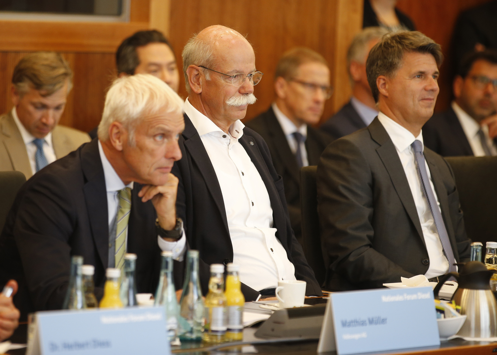 From right to left :  Harald Krueger, CEO of German car maker BMW, Dieter Zetsche, chairman of German car maker Daimler AG and head of Mercedes-Benz c...