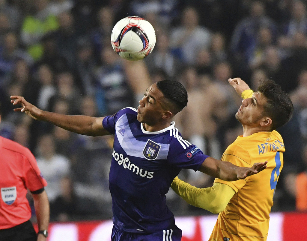 FILE - In this March 16, 2017 file photo, Anderlecht's Youri Tielemans, left, goes up against APOEL's Kostakis Artymatas during a Europa League round ...