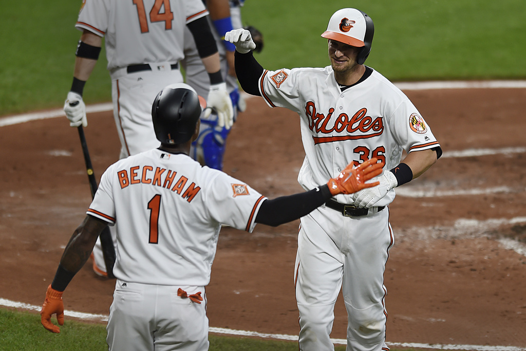 Baltimore Orioles' Caleb Joseph, right, is congratulated by Tim Beckham after hitting a two run home run against the Kansas City Royals in the second ...