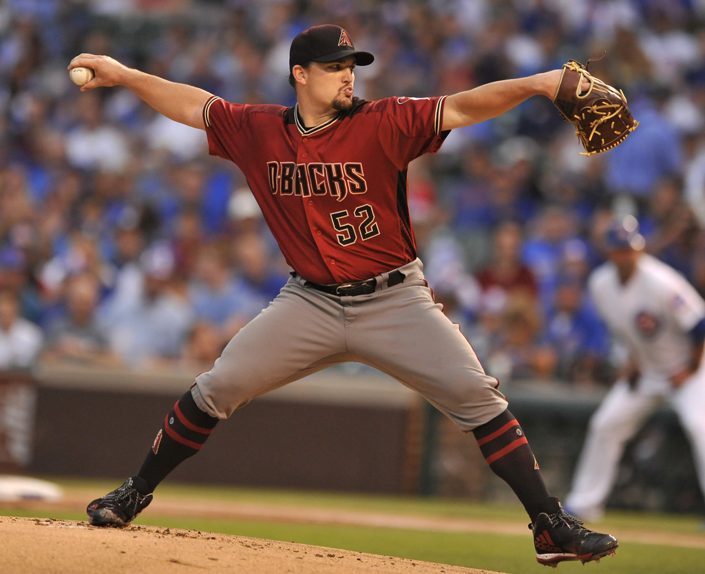 Arizona Diamondbacks starter Zack Godley delivers a pitch during the first inning of a baseball game against the Chicago Cubs Wednesday, Aug. 2, 2017,...