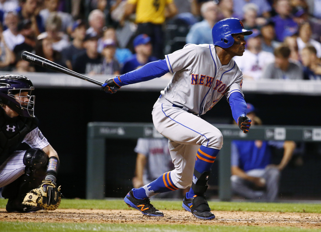 New York Mets' Curtis Granderson watches his three-run home run against the New York Mets during the sixth inning of a baseball game Wednesday, Aug. 2...