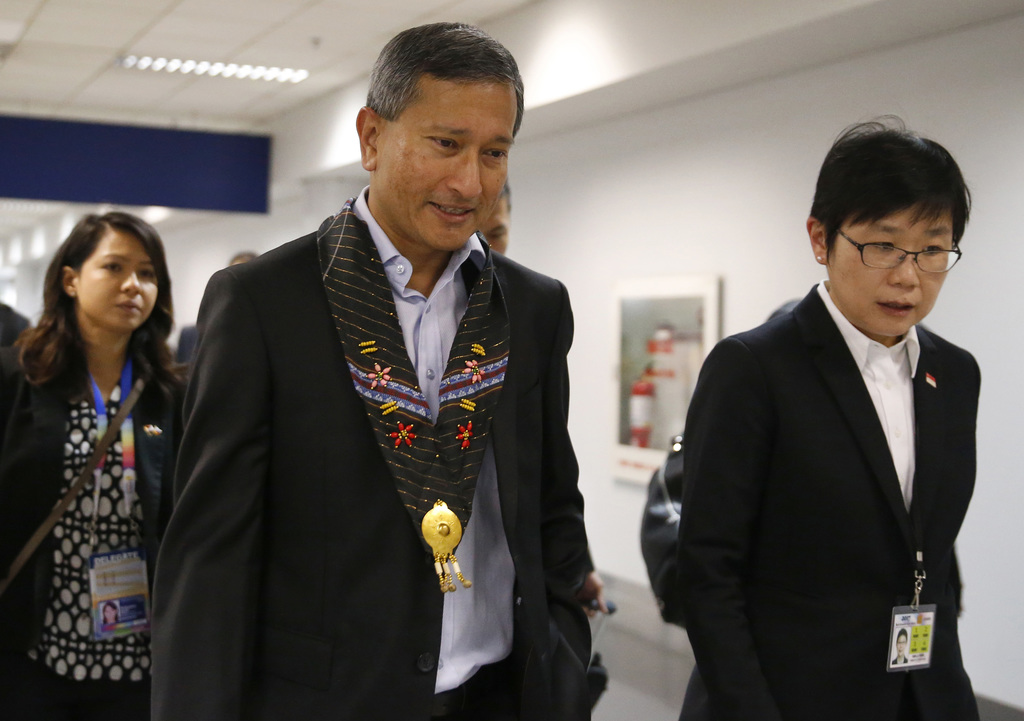 Singaporean Foreign Minister Vivian Balakrishnan, center, walks to his limousine shortly upon arrival for the Aug.2-8, 2017 50th ASEAN Foreign Ministe...