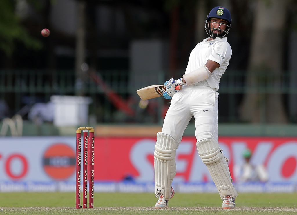India's Cheteshwar Pujara avoids a rising delivery during their second cricket test match against Sri Lanka in Colombo, Sri Lanka, Thursday, Aug. 3, 2...