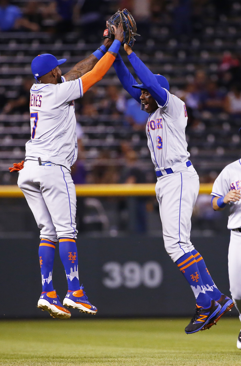 New York Mets center fielder Curtis Granderson (3) celebrates the team's 10-5 win over the Colorado Rockies with Jose Reyes (7) following a baseball g...