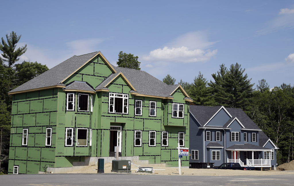 This Monday, July 10, 2017, photo shows new housing construction, in North Andover, Mass. On Thursday, Aug. 3, 2017, Freddie Mac reports on the week's...