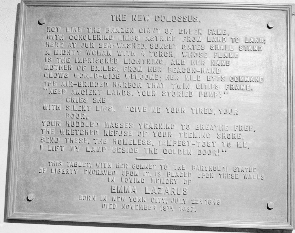 FILE- In this circa 1950 photo shows a bronze plaque of the poem by Poet Emma Lazurus on Statue of Liberty in New York. In 1903, the poem was engraved...