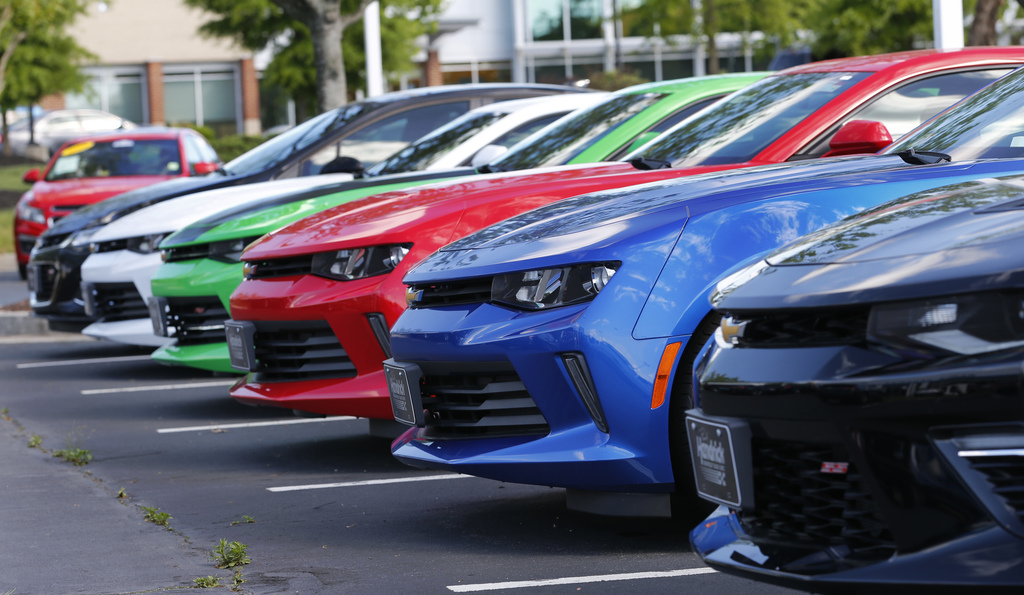 In this Wednesday, April 26, 2017, photo, Chevrolet Camaros are lined up in the lot of a Chevrolet dealership in Richmond, Va. As the end of your car ...