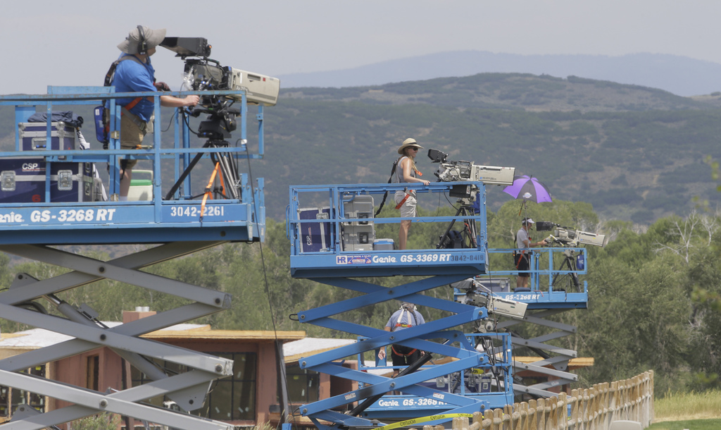 In this July 11, 2017, photo, cameras film play during a MLS video replay scrimmage organized in a community park, in Park City, Utah. The games were ...