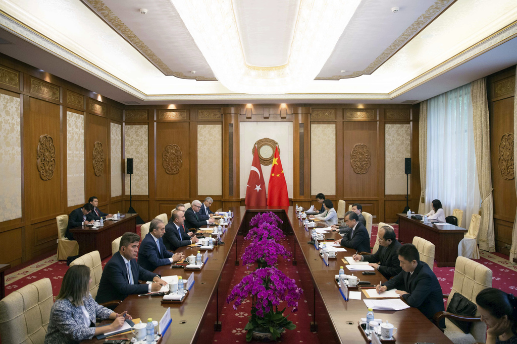 Chinese Foreign Minister Wang Yi, center right, during the meeting with Turkish Foreign Minister Mevlut Cavusoglu, center left, at Diaoyutai State Gue...