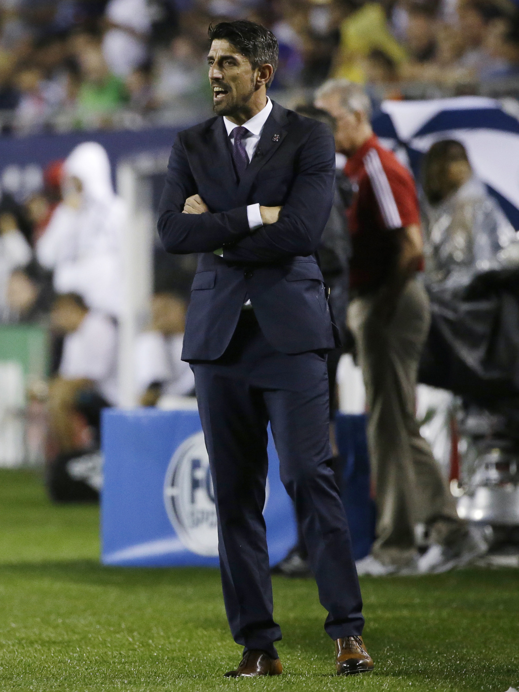 MLS All-Stars coach Veljko Paunovic talks to his players during the first half of the MLS All-Star Game against Real Madrid, Wednesday, Aug. 2, 2017, ...