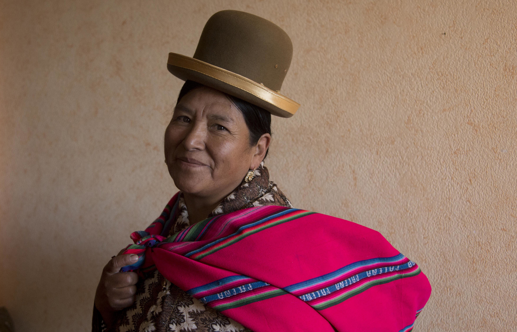 In this July 20, 2017 photo, midwife Ana Choque poses for a portrait before leaving her home to visit a pregnant patient for pre-natal care in El Alto...
