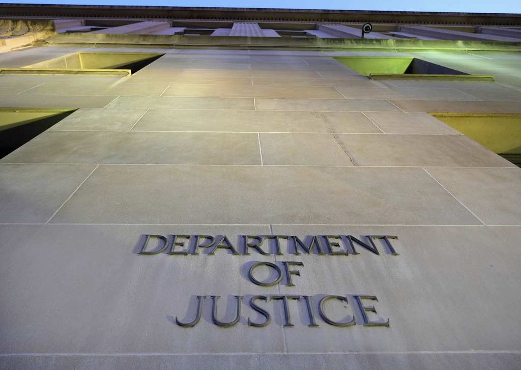 FILE - In this May 14, 2013 file photo, the Justice Department headquarters building in Washington. The Trump administration is signaling that it will...
