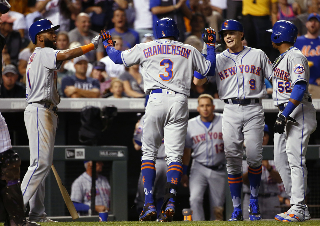 New York Mets' Curtis Granderson (3) is congratulated by teammates Amed Rosario, left, Brandon Nimmo (9) and Yoenis Cespedes after hitting a three-run...