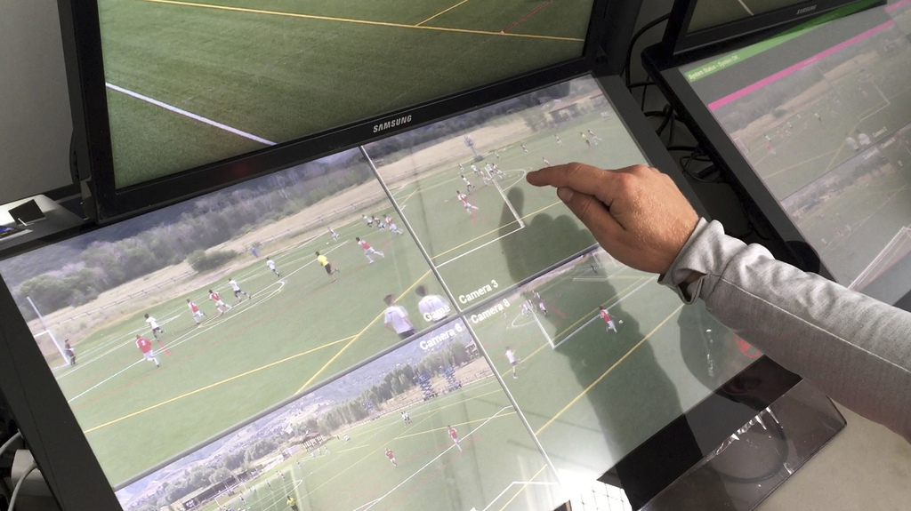In this July 11, 2017, still image from video, MLS referee Dave Gantar points at the screen during a video replay scrimmage organized in a community p...