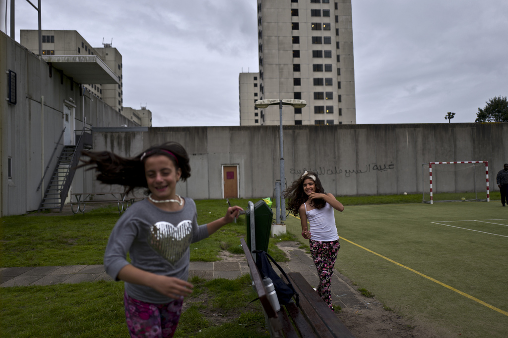 In this Friday, July 28, 2017 photo, Syrian refugee girls, Mishleen Samir, 10, right, from Damascus, and her friend Claire Alzain, 10, from Damascus, ...