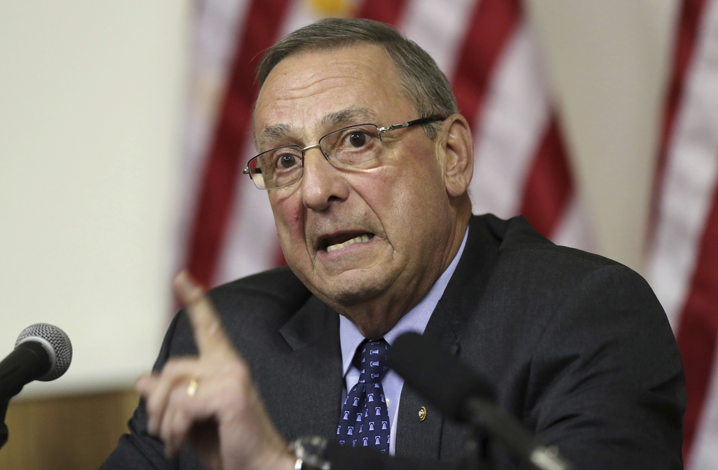 FILE - In this Wednesday, March 8, 2017, file photo, Maine Gov. Paul LePage speaks at a town hall meeting, in Yarmouth, Maine. LePage says taking down...