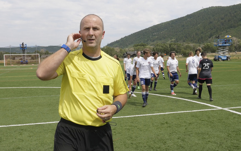 In this July 11, 2017, still image from video, MLS referee Silviu Petrescu tests an earpiece and mic used to communicate with a video assistant refere...