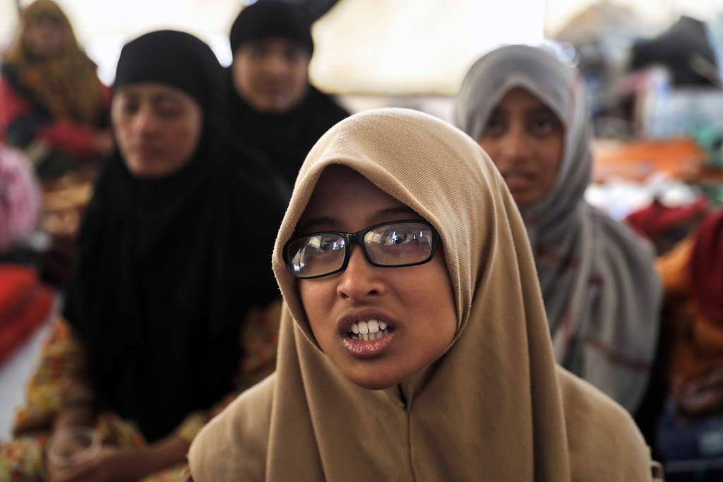 In this picture taken on Monday, July 24, 2017, Nurshardrina Khairadhinia, 19, from Indonesia, the cousin of a young man suspected of Islamic State me...