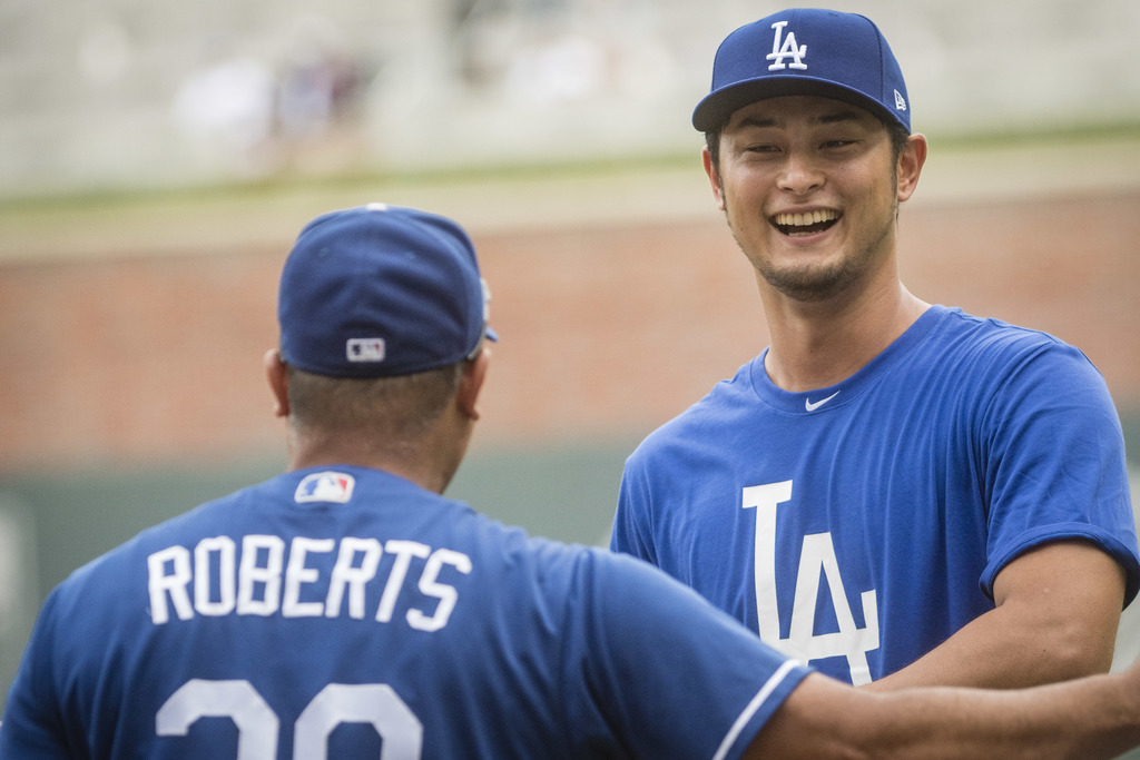 Los Angeles Dodgers' Yu Darvish, right, talks to manager Dave Roberts before a baseball game against the Atlanta Braves, Wednesday, Aug. 2, 2017, in A...