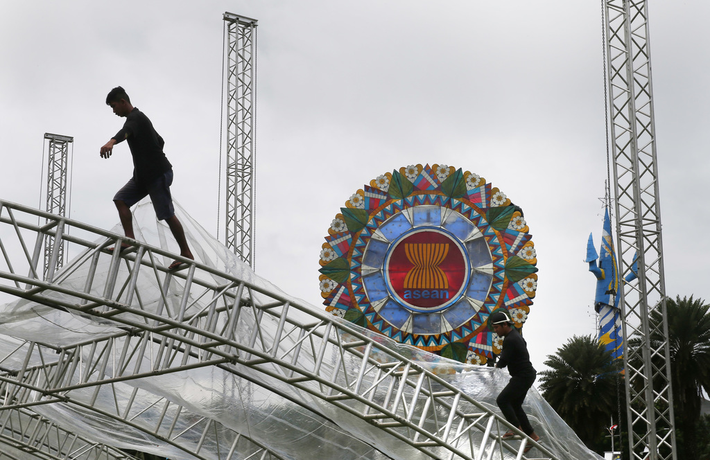Workers install a giant lantern with the logo of ASEAN, Association of Southeast Asian Nations, in preparation for the Aug.2-8, 2017 50th ASEAN Foreig...