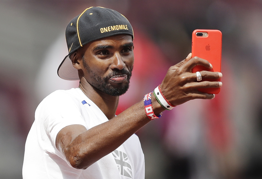 Britain's Mo Farah takes a selfie during a training session before the World Athletics Championships in London Thursday, Aug. 3, 2017. (AP Photo/Tim I...