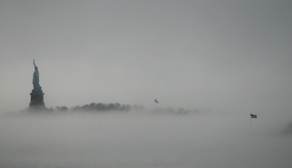 FILE - In this Jan. 11, 2014, file photo, the Statue of Liberty is surrounded by fog on Liberty Island in New York. Senior White House aide Stephen Mi...