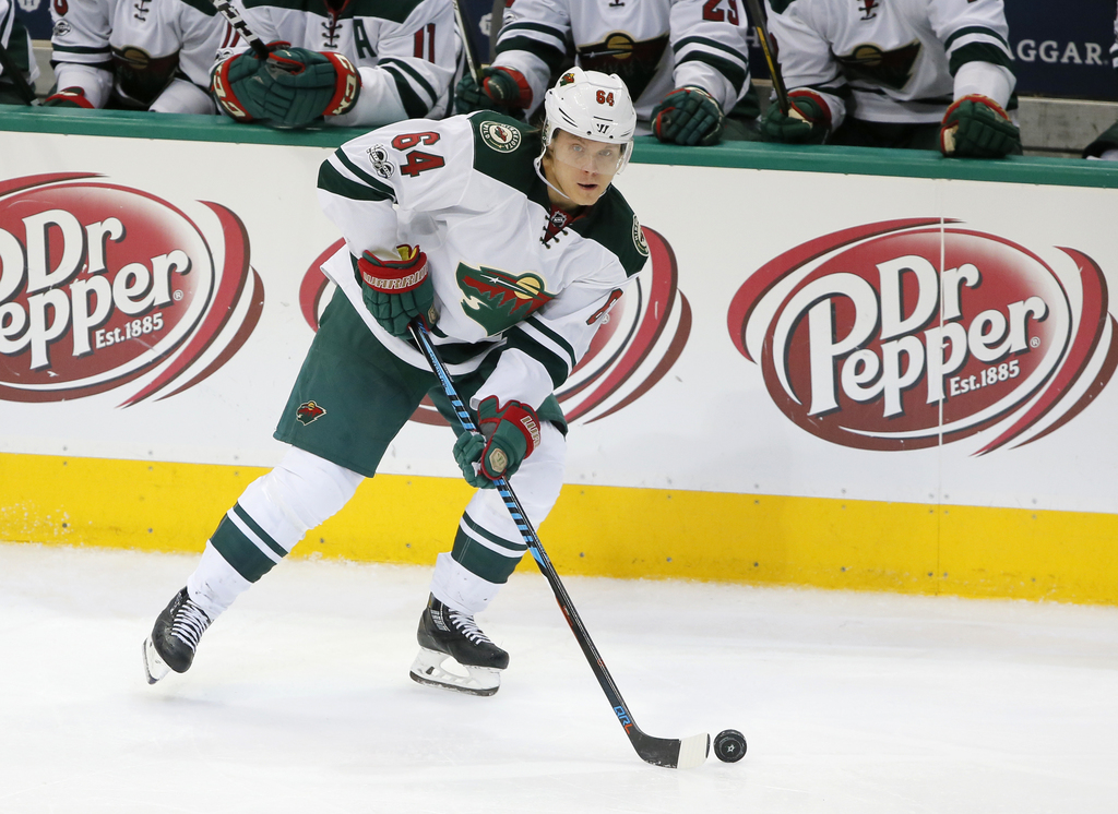 FILE - In this Jan. 24, 2017, file photo, Minnesota Wild's Mikael Granlund (64), of Finland, handles the puck during an NHL hockey game against the Da...