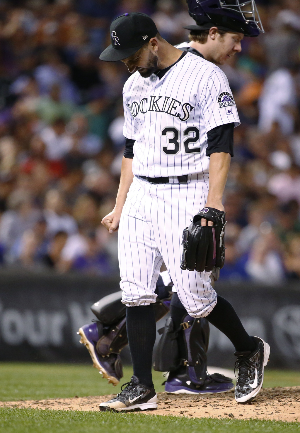 Colorado Rockies starting pitcher Tyler Chatwood heads to the dugout after giving up a three-run home run to New York Mets' Curtis Granderson during t...