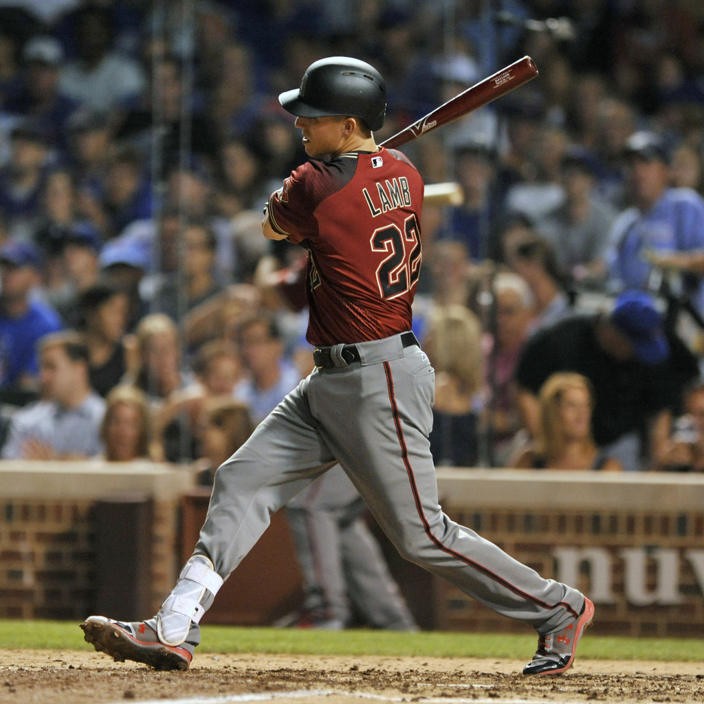 Arizona Diamondbacks' Jake Lamb watches his two RBI double during the sixth inning of a baseball game against the Chicago Cubs Wednesday, Aug. 2, 2017...