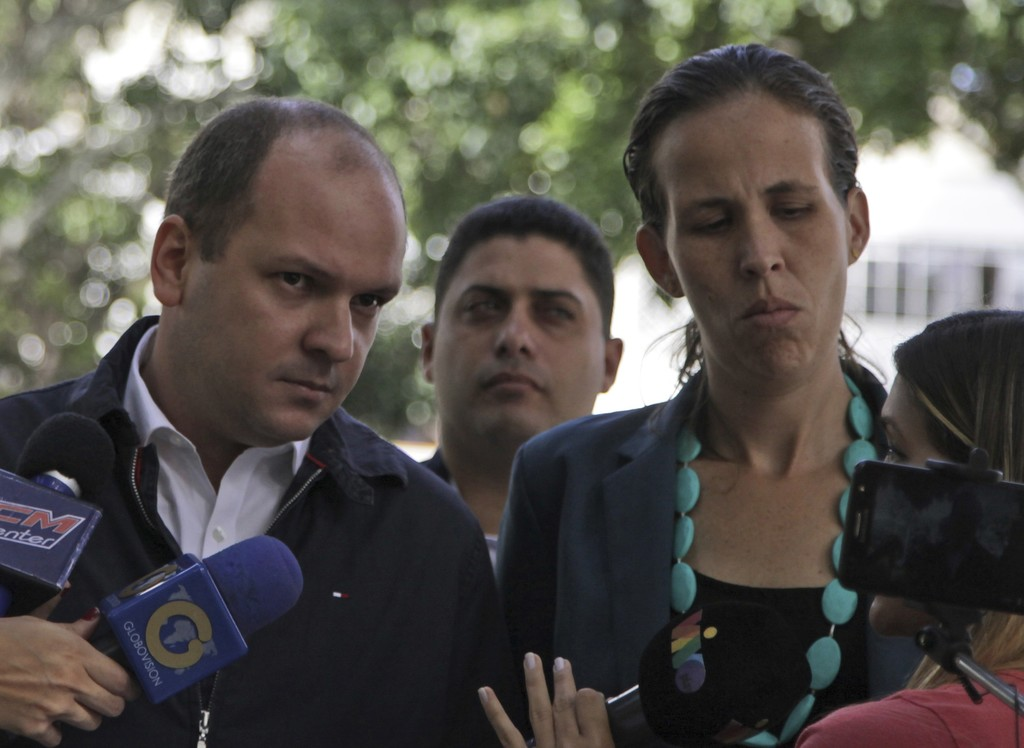 Opposition lawmakers Angel Medina, left, and Manuela Bolivar speak with the media upon their arrival to Venezuelan General Prosecutor's office to intr...