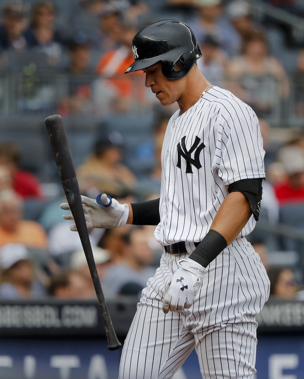 New York Yankees' Aaron Judge flips his bat after striking out against the Detroit Tigers during the third inning of a baseball game, Wednesday, Aug. ...