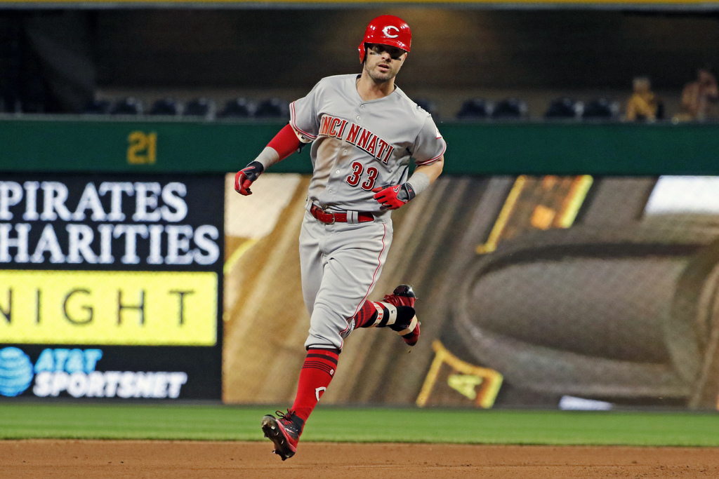 Cincinnati Reds' Jesse Winker rounds second after hitting a solo home run off Pittsburgh Pirates relief pitcher Joaquin Benoit during the seventh inni...