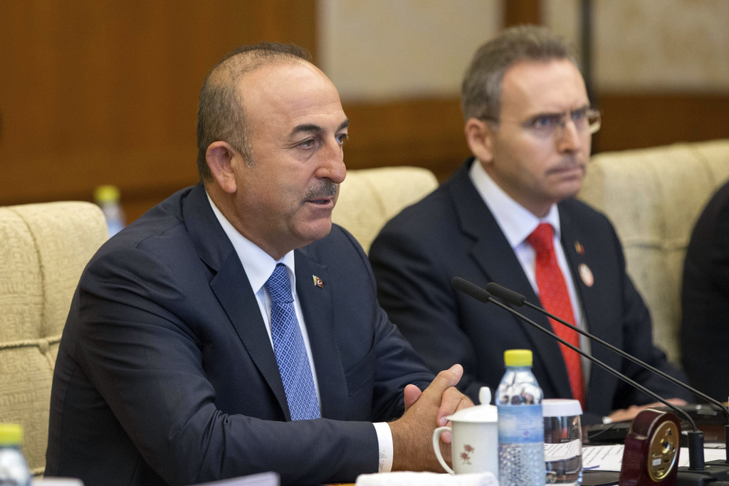 Turkish Foreign Minister Mevlut Cavusoglu, left, speaks during the meeting with Chinese Foreign Minister Wang Yi at Diaoyutai State Guesthouse in Beij...