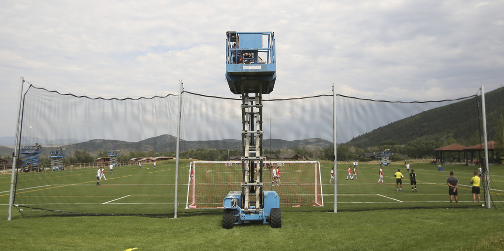 In this July 11, 2017, photo, a camera films play during a MLS video replay scrimmage organized in a community park, in Park City, Utah. The games wer...
