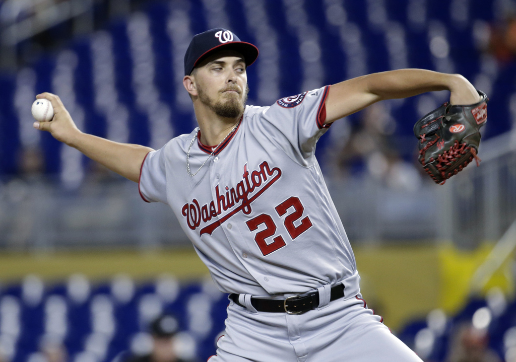 Washington Nationals starting pitcher A.J. Cole delivers during the first inning of the team's baseball game against the Miami Marlins, Wednesday, Aug...