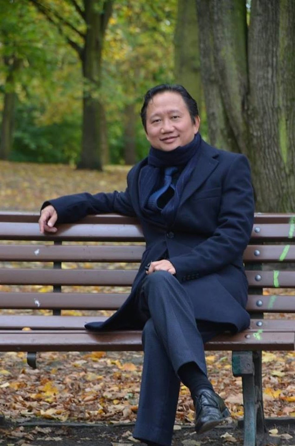 The undated image provided on Aug. 2, 2017 show Trinh Xuan Thanh, a businessman and former functionary of Vietnam's Communist Party sitting on a park ...