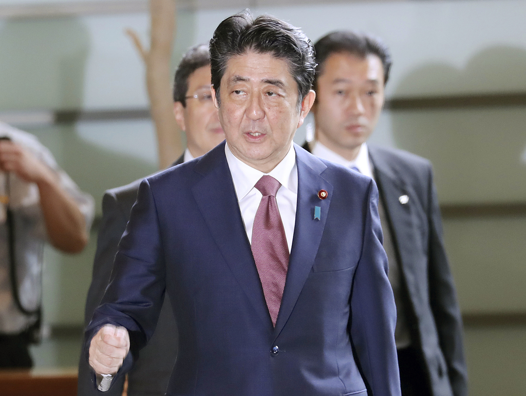 Japan's Prime Minister Shinzo Abe enters his official residence in Tokyo Thursday, Aug. 3, 2017. Abe will reshuffle his Cabinet to replace some of his...