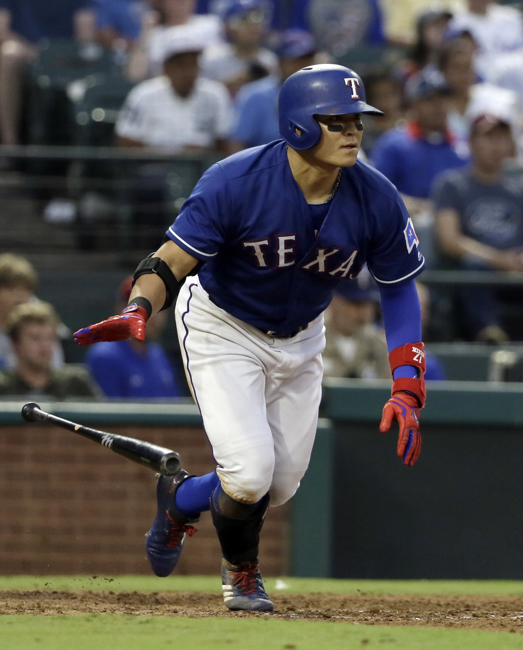Texas Rangers' Shin-Soo Choo sprints to first after hitting a single to right off of Seattle Mariners starting pitcher Ariel Miranda during the fourth...