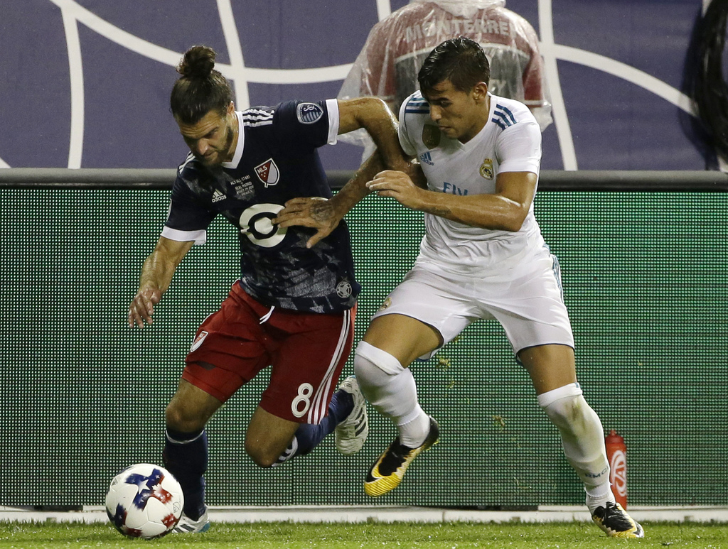 MLS All-Stars' Graham Zusi, left, controls the ball against Real Madrid's Theo Hernandez during the first half of the MLS All-Star Game, Wednesday, Au...