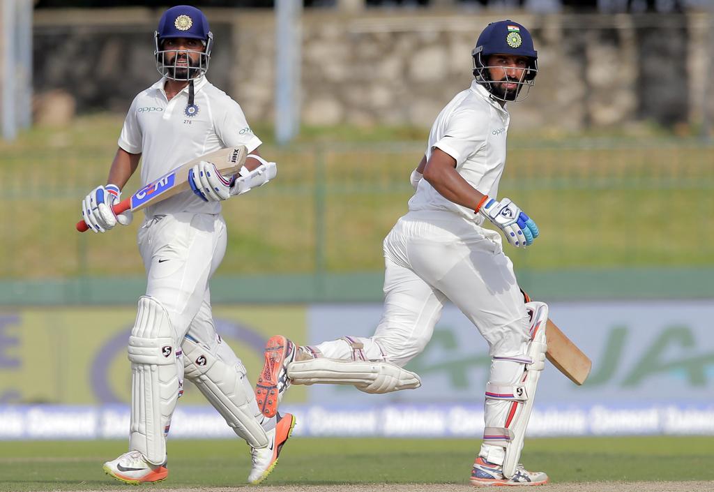 India's Ajinkya Rahane, left, and Cheteshwar Pujara run between the wickets during their second cricket test match against Sri Lanka in Colombo, Sri L...