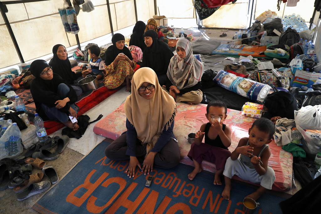 In this picture taken on Monday, July 24, 2017, an Indonesian family who escaped from the Islamic State group in Raqqa gather inside their tent at a r...