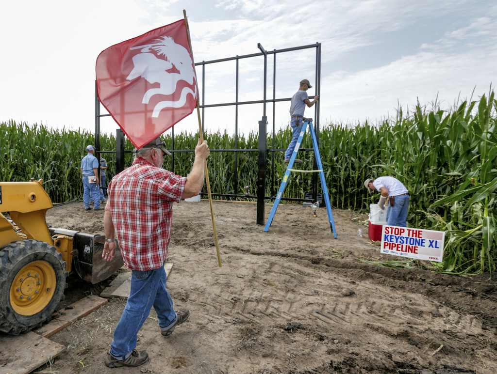 In this July 29, 2017 photo, activist Tom Genung of the organization Bold Nebraska is about to pitch a flag of the Cowboy Indian Alliance at the propo...