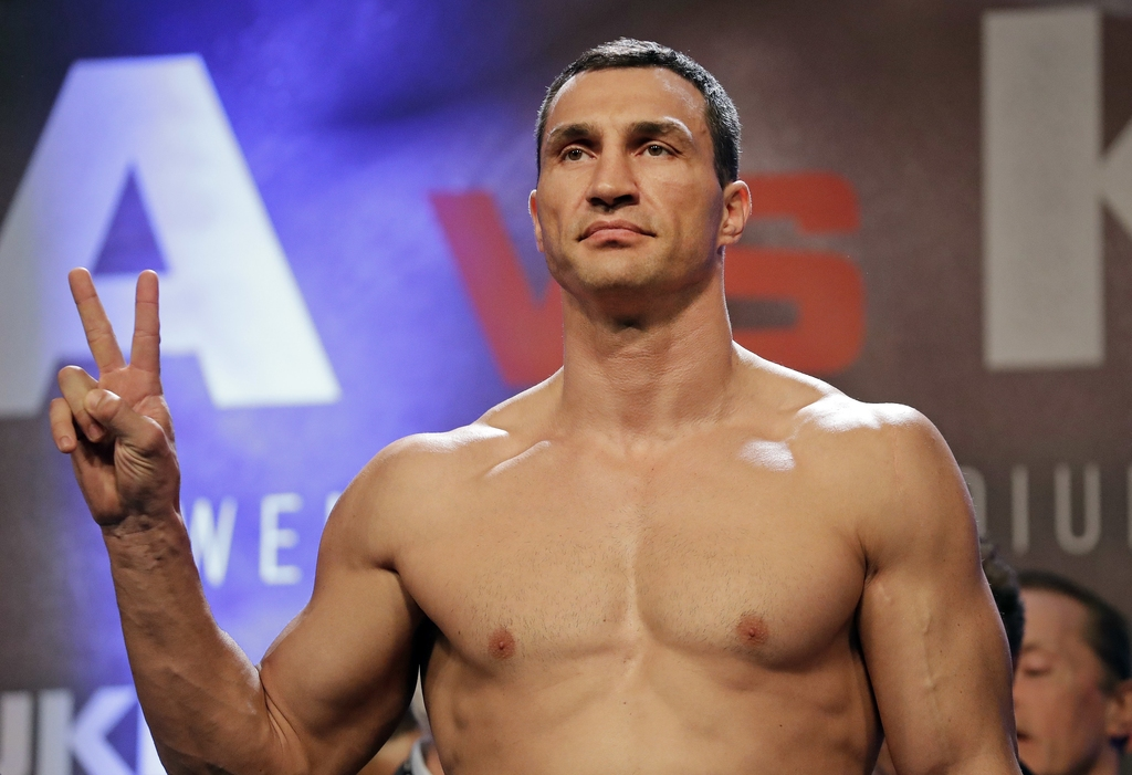 FILE - In this file photo taken on Friday, April 28, 2017, Ukrainian 41-year-old boxer Wladimir Klitschko, gestures as he takes part in the weigh-in f...