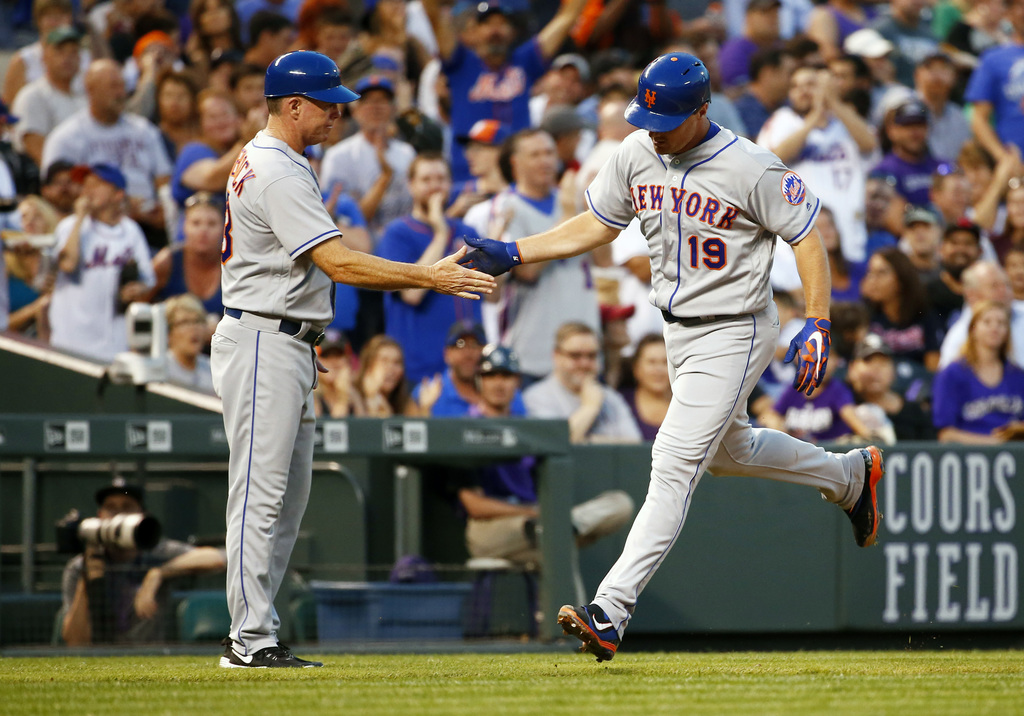 New York Mets' Jay Bruce (19) is congratulated by third base coach Glenn Sherlock (53) after hitting a solo home run off Colorado Rockies starting pit...