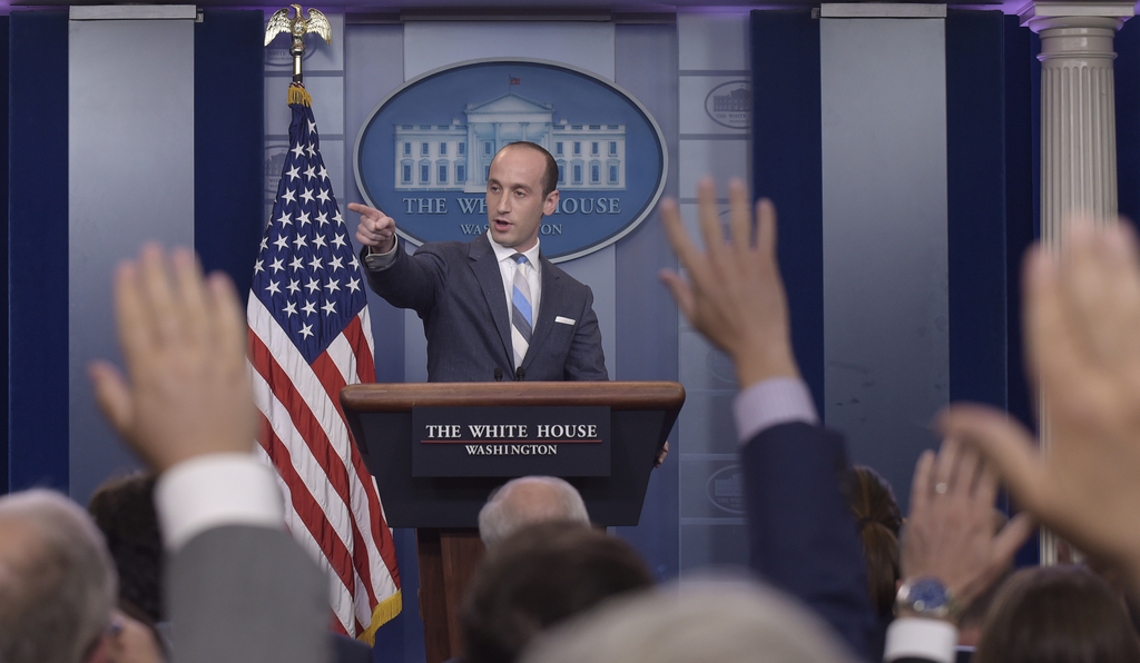 White House senior policy adviser Stephen Miller calls on a reporter during the daily briefing at the White House in Washington, Wednesday, Aug. 2, 20...