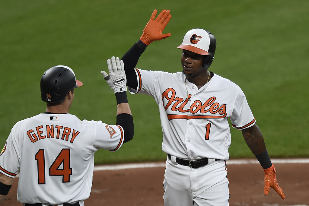 Baltimore Orioles' Tim Beckham, right, is congratulated by Craig Gentry after scoring against the Kansas City Royals on a home run by Caleb Josephin t...